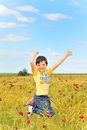 Happy Boy Jumping On Field Stock Photos - 18164673