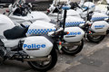 Police Cycles Lined Behind Police Car. Stock Images - 18191544