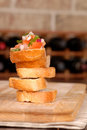 Stack Of Bruschetta With Wine Rack In Background Royalty Free Stock Photo - 1823405
