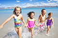 Happy Children Playing And Splashing In The Ocean Royalty Free Stock Image - 18213696