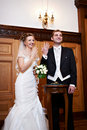 Joyful Bride And Groom At Solemn Registration Royalty Free Stock Photography - 18216847
