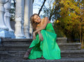 Beauty Woman In Green Clothes Sit On Stair Stock Photo - 18362330