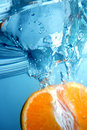 Fresh Orange Into Blue, Clear Water Royalty Free Stock Images - 1844109