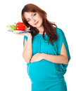 A Pregnant Woman With A Plate Of Vegetables Royalty Free Stock Photography - 18456527