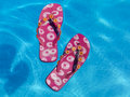 Colorful Flipflops Floating In A Swimming Pool Royalty Free Stock Photography - 18484307