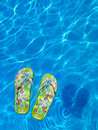 Colorful Flipflops Floating In A Swimming Pool Royalty Free Stock Photos - 18484308