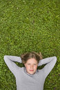Young Girl Lying In The Grass Dreaming Of ... Stock Images - 18484324