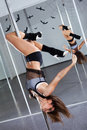 Young Woman Dancing With Pole Royalty Free Stock Images - 18493549