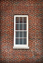 White Window Isolated By Red Brick Stock Image - 18640631