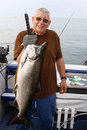 Man With Large Fish - King Salmon Royalty Free Stock Images - 18644919
