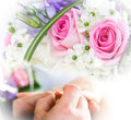 Hands And Rings On Wedding Bouquet Stock Image - 18675761