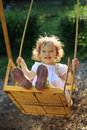 Playing On The Swings Stock Image - 18725131