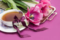 Violet Tulips And Cup Of Tea Stock Photos - 18796163