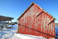 Stockfish And Red Cabin At Sunset Royalty Free Stock Photo - 18797785