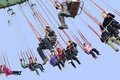 Happy People Play Chairoplane In An Amusement Park Royalty Free Stock Photos - 18810968