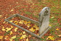 Old Tombstone And Autumn Leaves Royalty Free Stock Image - 18817896