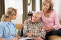 Senior Couple Talking To Health Visitor Stock Photography - 18914742