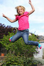 Happy Girl Jumping Stock Images - 18988404