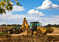 Front End Loader With Backhoe In Action Royalty Free Stock Photos - 19040348
