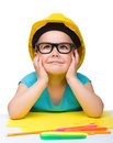 Cute Little Girl Is Playing While Wearing Hard Hat Stock Photography - 19176722