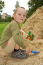 Little Boy Play With Sand Stock Photo - 19178400