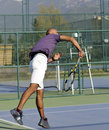 Serving A Tennis Ball Royalty Free Stock Photography - 19193587