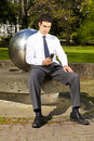Businessman Relaxing In Park During Lunch Break Royalty Free Stock Photography - 19258047