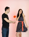 Lovely Romantic Man Giving Flower To A Woman Stock Images - 19361244