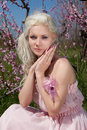 Young Pretty Blond Woman In Blooming Garden Royalty Free Stock Photo - 19396645