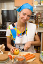 Blond Girl Cooking In The Kitchen Royalty Free Stock Photography - 1948107