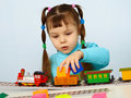 Little Girl Preschooler Playing With Toy Railway Royalty Free Stock Photos - 19471208