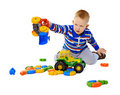 Little Boy Playing Actively With Plastic Toys Stock Image - 19471221