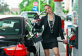 Woman In Gas Station Stock Photography - 19555252