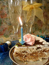 Celebratory Table (piece Of Birthday Cake And Blue Candle, Two G Royalty Free Stock Image - 1962406