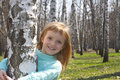 Smiling Girl In Birch Grove Royalty Free Stock Images - 19615859