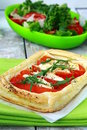 Tart Of Puff Pastry With Peppers And Goat Cheese Stock Photos - 19667183