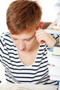 Teen Boy Learning At The Desk  Stock Photography - 19679812