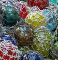 Glass Fishing Floats With Netting Royalty Free Stock Photography - 19694627