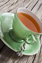 Green Antique Tea Cup With Healthy Organic Tea Stock Photo - 19732950