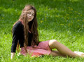 Girl Sitting In Th Park Royalty Free Stock Photography - 19769357