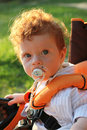 Beautiful Red-haired Boy In Pram Royalty Free Stock Image - 19799676