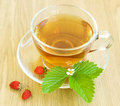 Tea And Wild Strawberries Stock Images - 19839864