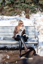 Woman In A Winter Park Sits On A Bench Stock Images - 19880474