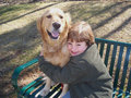 Boy And Dog On Bench Royalty Free Stock Photography - 1992307