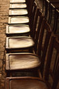 Row Of Old Wooden Chairs Royalty Free Stock Photography - 19934467