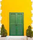 Green Door In The Orange Wall Royalty Free Stock Image - 19942056