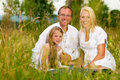 Happy Family Sitting In Meadow Royalty Free Stock Photography - 20035507