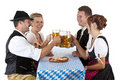 Bavarian Men And Women Toast With Beer Stein Royalty Free Stock Photos - 20064768
