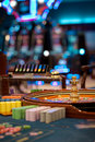 Roulette Wheel Table With Chips Piles Stock Image - 20065391