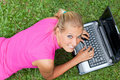 Young Attractive Woman Works On Her Laptop Royalty Free Stock Image - 20077436